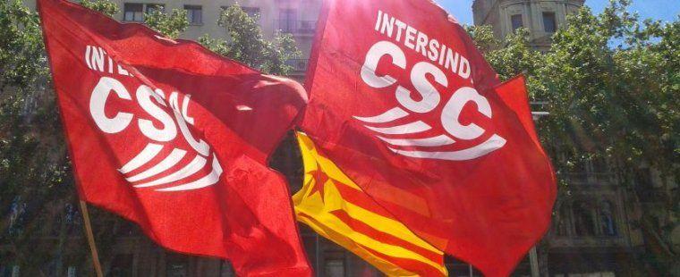 Banderes de la Intersindical-CSC i una estelada