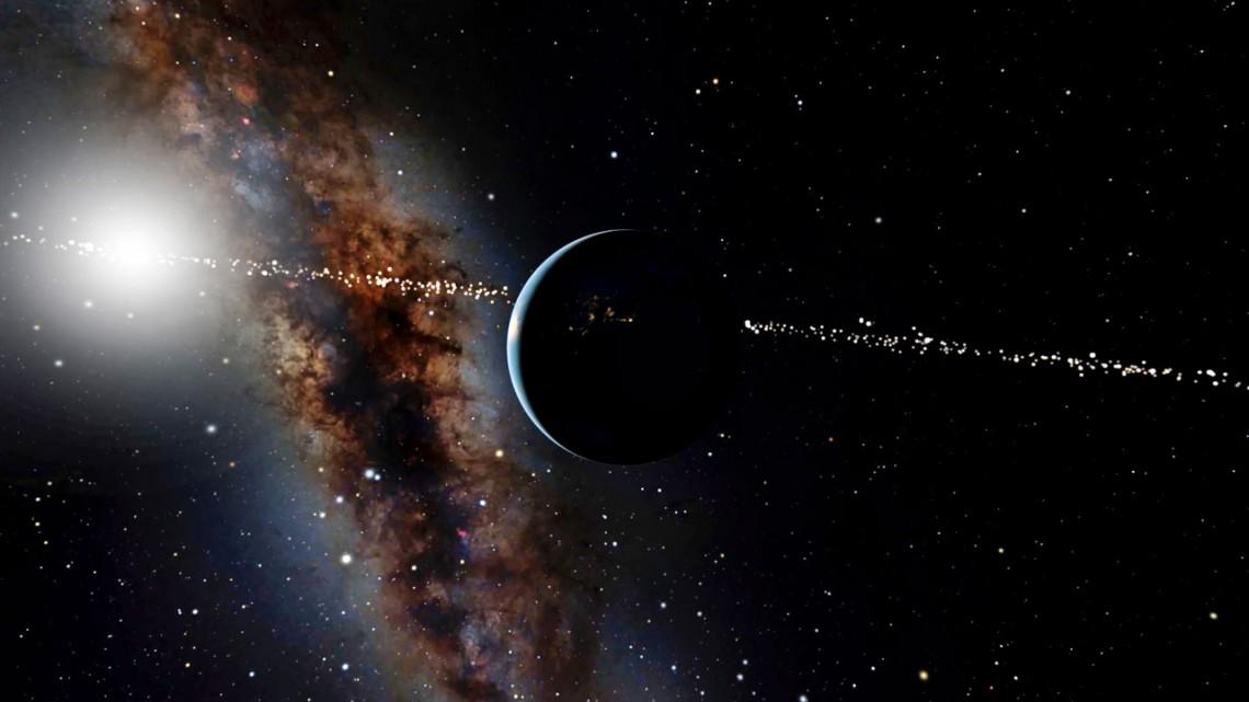 Imatge artística de la Terra vista des de l'espai, amb el pla de la Via Làctia al fons | OpenSpace/American Museum of Natural History